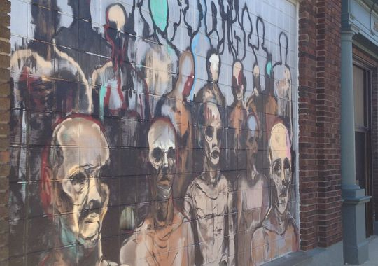 "This painting by Sagan Newham on the side of Haywood Printing, Fifth and Ferry streets, brought some complaints about the ""small spaces: Lafayette"" public art project. According to the project curator, the piece will stay up until Halloween and then be replaced. (Photo: Dave Bangert/Journal & Courier)"